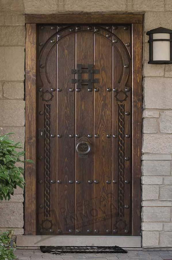 Puerta exterior r stica modelo arabe puertas innova s l u for Puertas macizas exterior