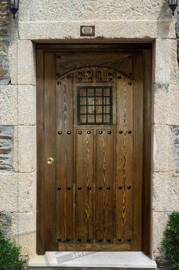 Puerta exterior r stica modelo 7 puertas innova s l u for Puertas macizas exterior