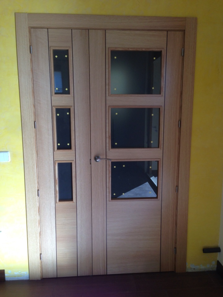Puertas de interior roble lisas greca negra puertas for Puertas de roble interior