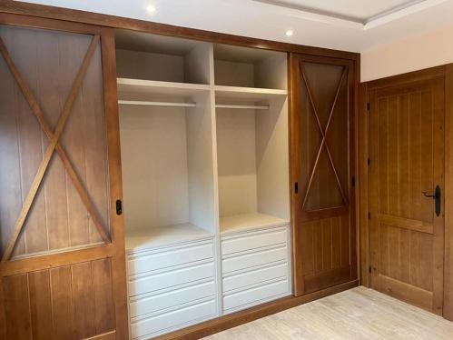frente de armario con aspas corredero interior en textil
